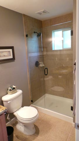 """Private attached bathroom to the bedroom. """"Our space was lovely and exactly as pictured. Tina was very gracious and accommodating. We had a great time and would definitely stay in her home again!"""""""