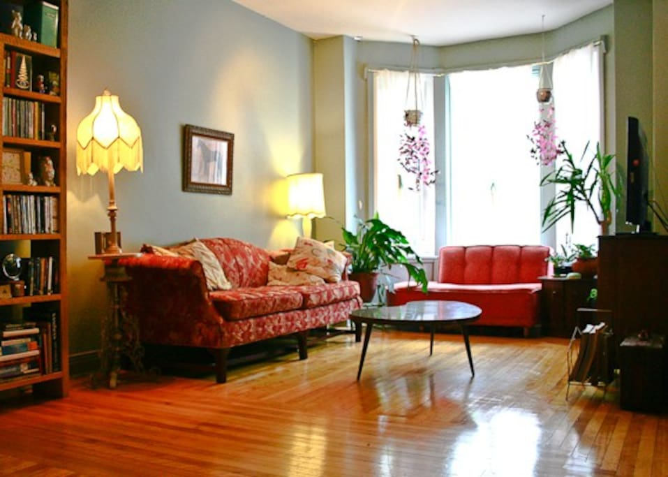 You'll enjoy lazing around in our cozy living room. This is the perfect place to sip on a glass of wine or a cup of tea while you listen to records on our stereo or watch a dvd on our flat screen t.v.