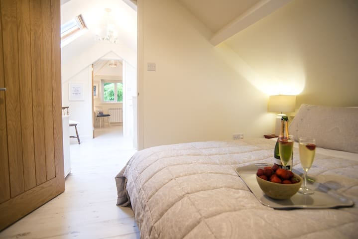 Master bedroom with its 5' divan, looking through the mezzanine area on towards the twin bedroom
