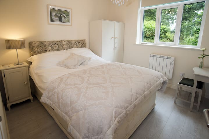"""The ground floor bedroom with a 4'6"""" divan bed. This bedroom is so useful for those that don't like using stairs."""