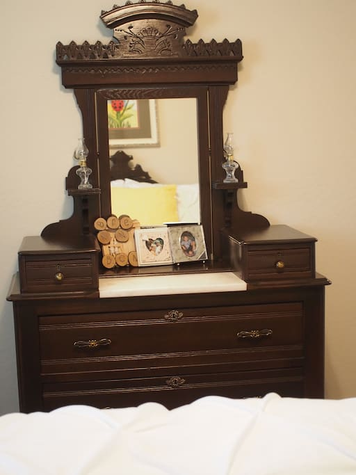 One of two dressers available for storage in the room.