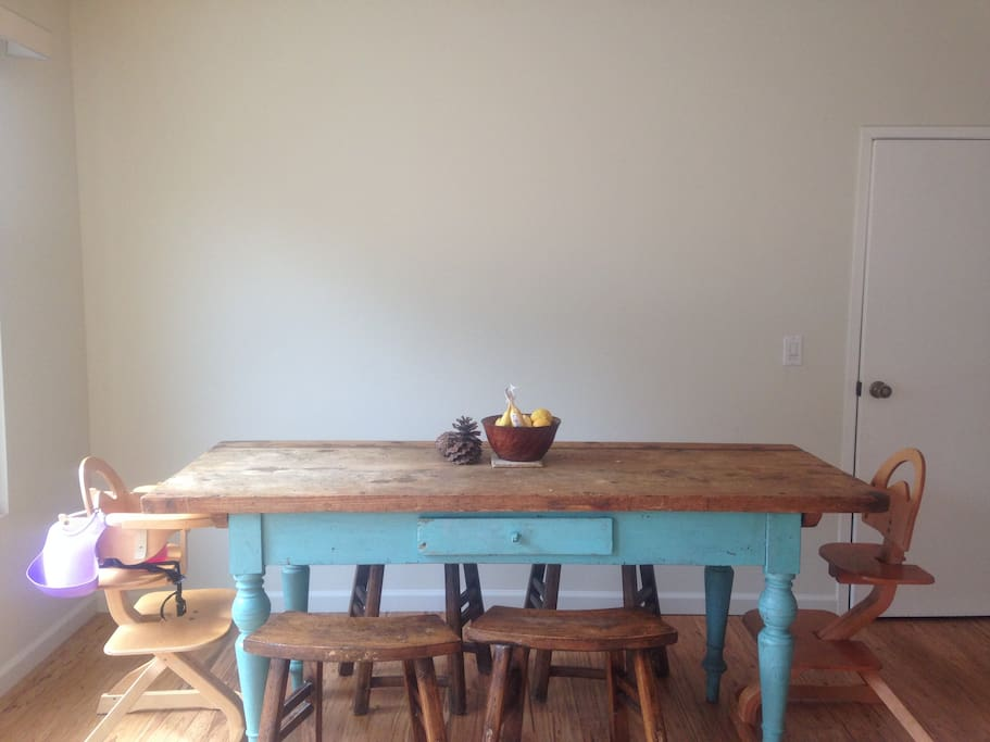 French farmhouse dining table perfect for large or small meals, looks out onto the patio.  High chairs optional