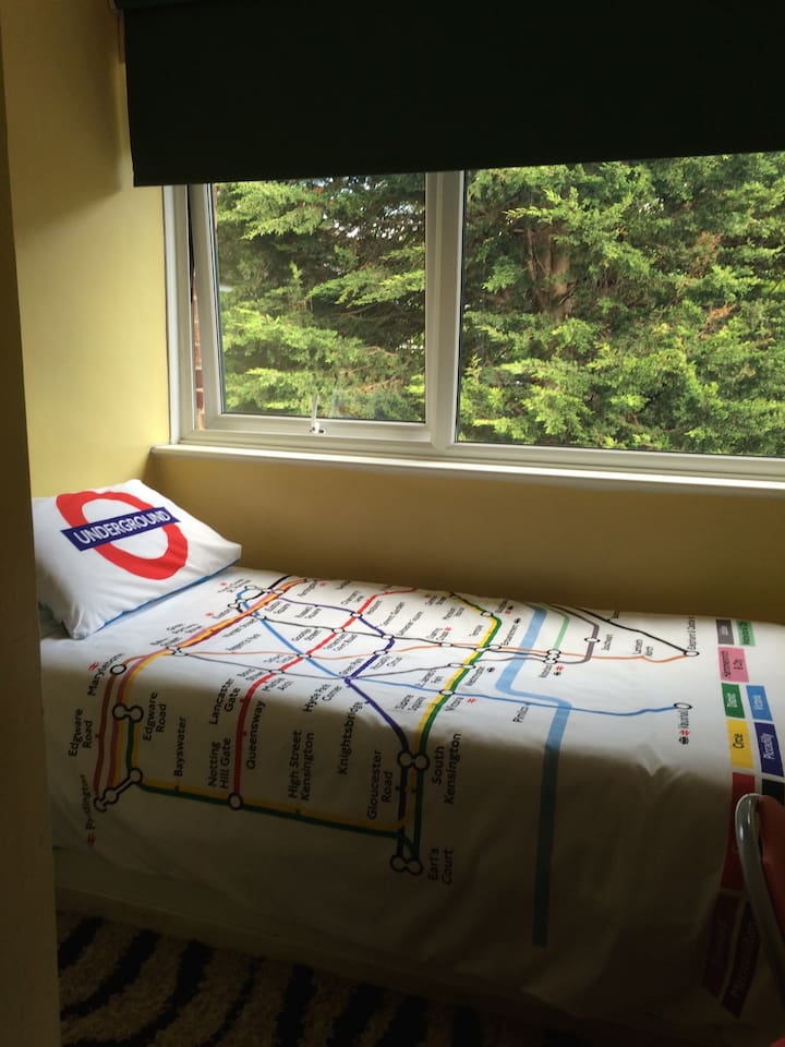 single bed, big window for a bright and safe environment