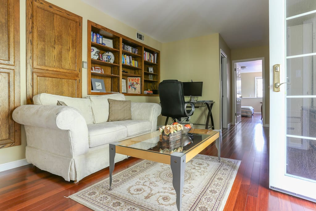 Cozy living area that's comfortably furnished. The bedroom and bathroom are at the end of the hall.