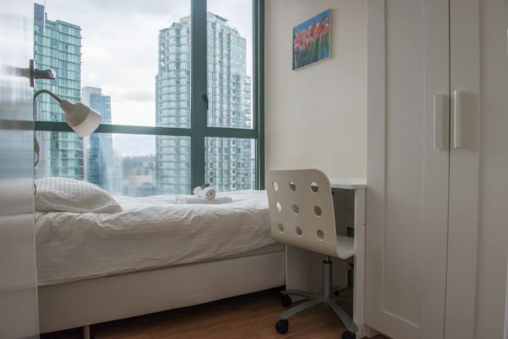 """Bedroom.   Luciano, Oct 2015: """"Incredibly clean and cozy environment. Central location very nice and classy building."""""""