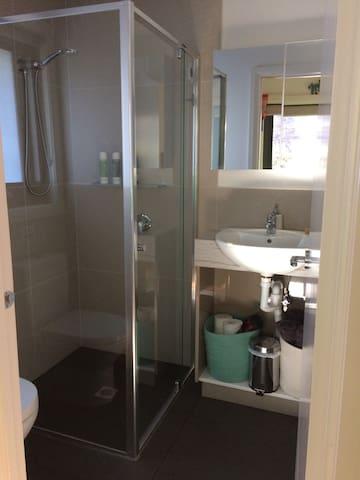 Bathroom sink, hairdryer, towels, toilet rolls, first aid kit, etc.