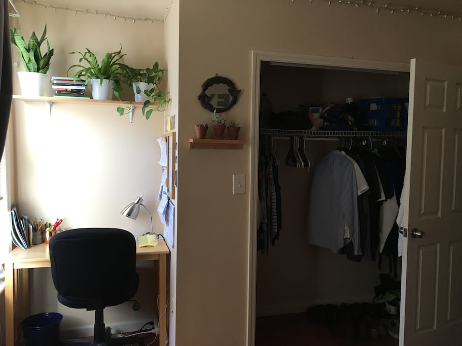 A small desk work place and closet