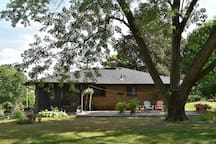Tranquil clean rear view of the house with brick paver patio overlooking 1/3 acre of land