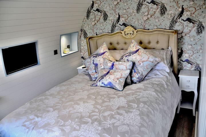Luxury king size french bed, with Hypnos mattress for a blissful,  relaxing nights sleep.