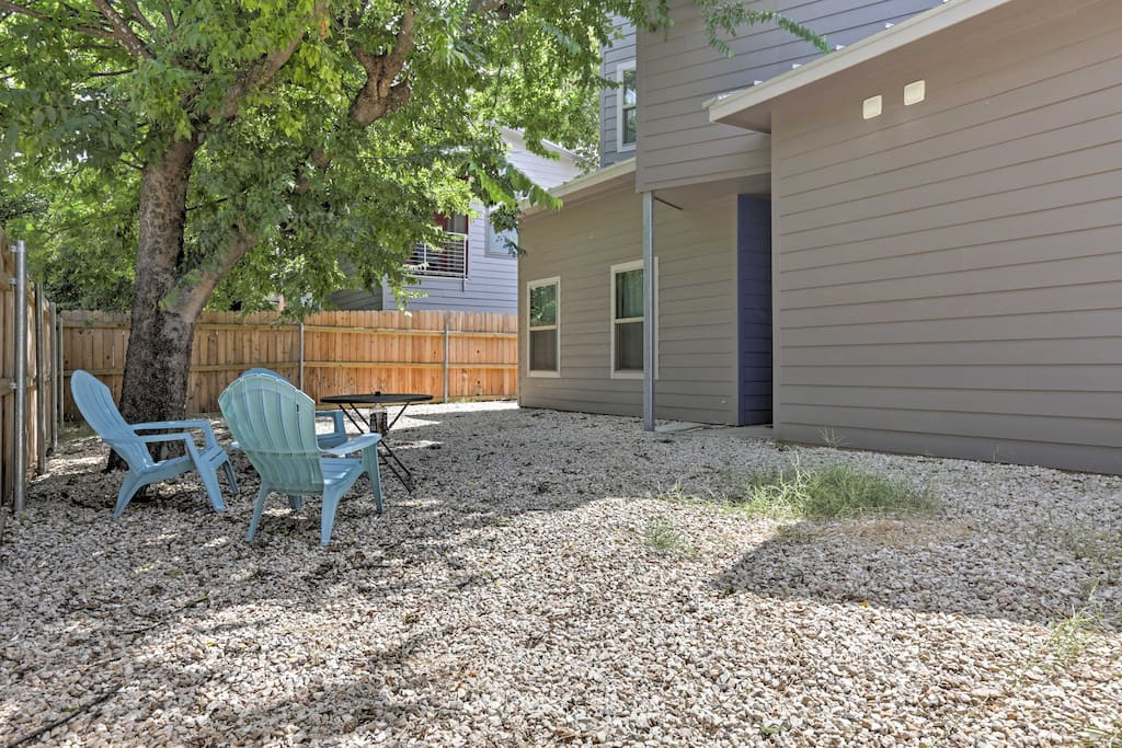 The home has a spacious, fenced-in backyard where you can sit back and soak up the sun.
