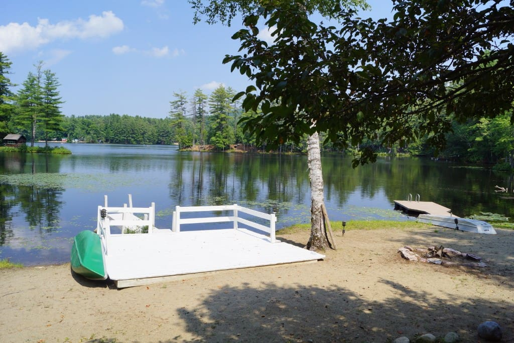 The dock, sun bathing and fire pit beach area.