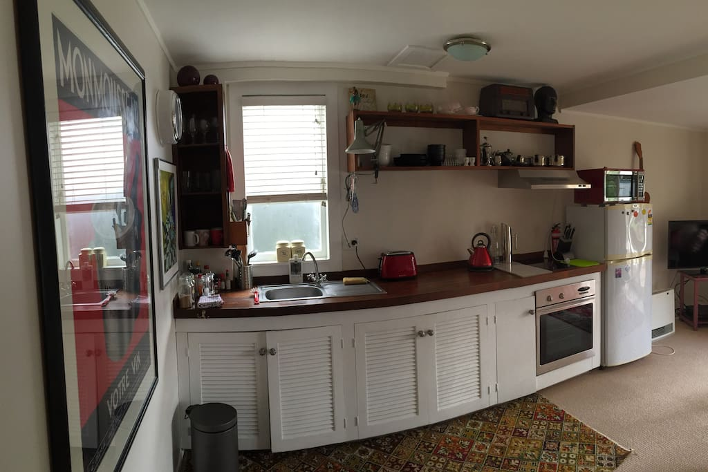Kitchen, Preparation Area, Sink, Stove Top, Microwave.