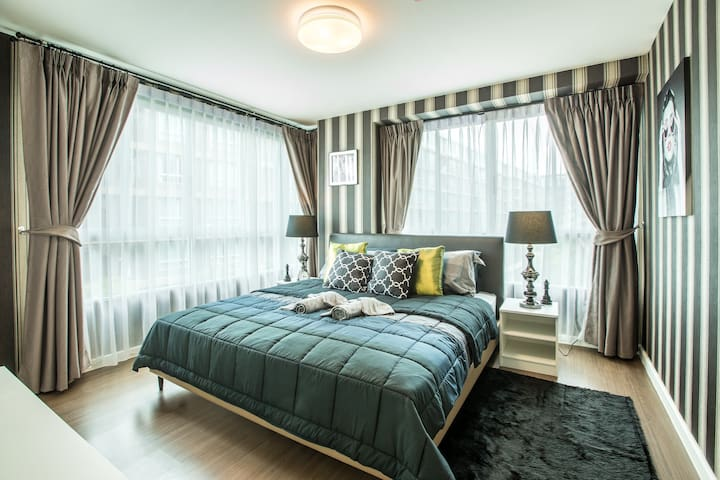 Master Bedroom with huge windows overlooking the gardens and the pool.