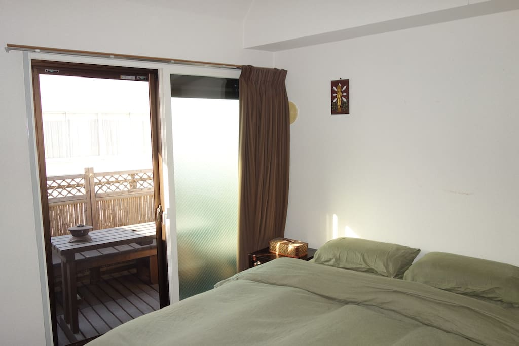 Bedroom connects with balcony terrace.