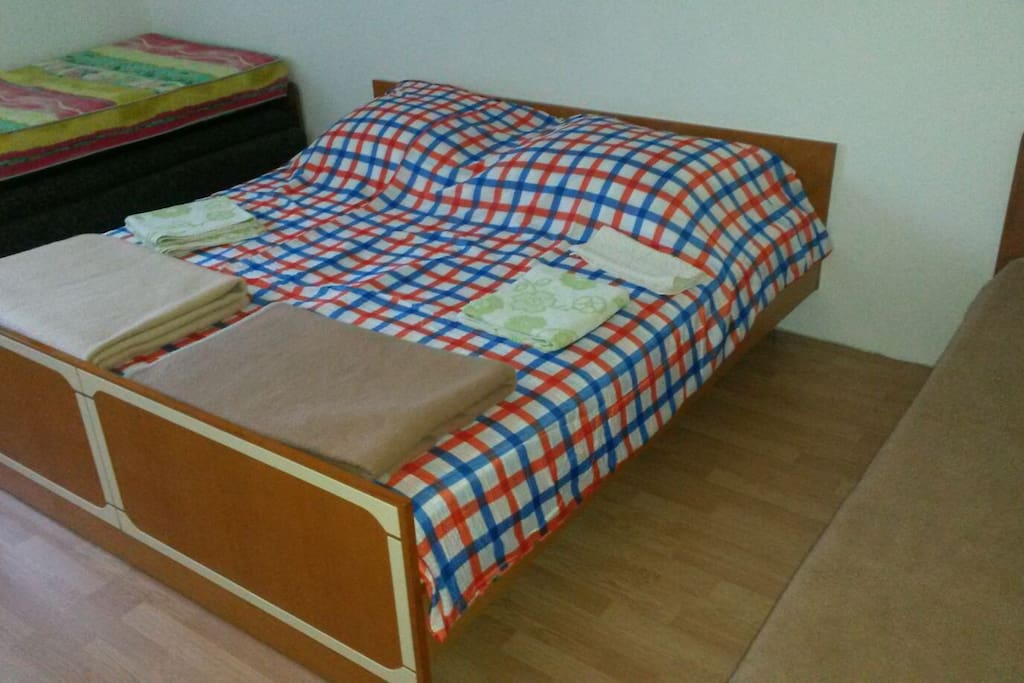 First bedroom with one king double bed, and other is single bed