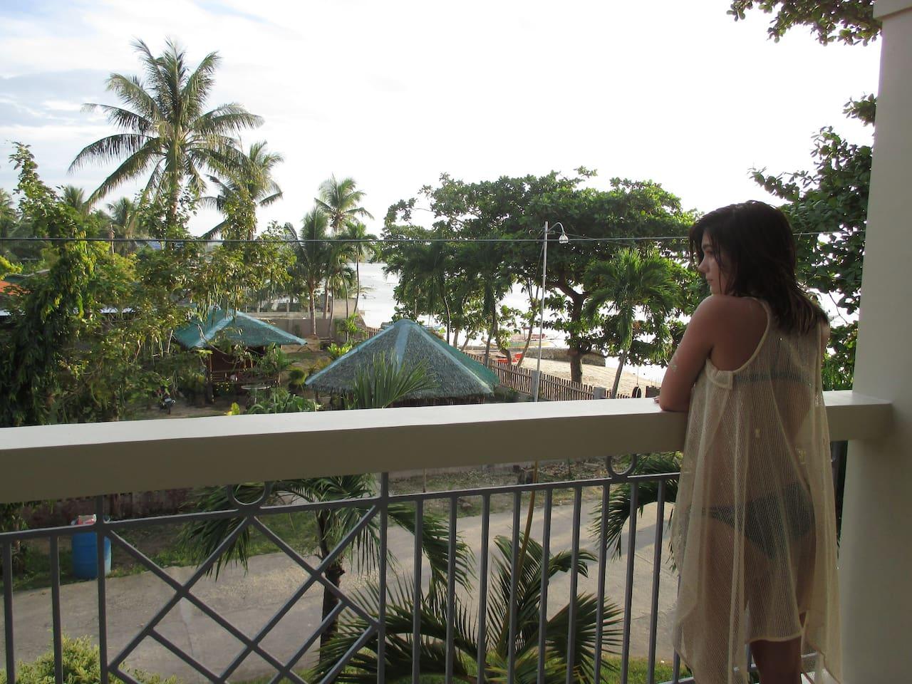 Balcony overlooking beach, street and neighborhood.
