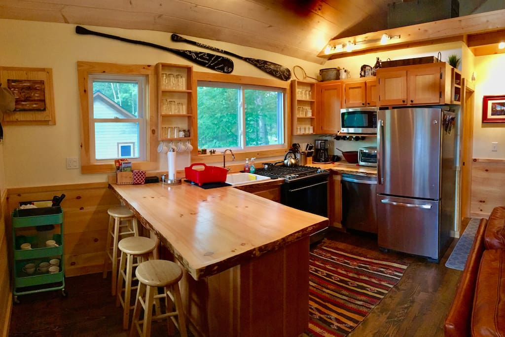 Full kitchen with gas stove, dishwasher, and disposal
