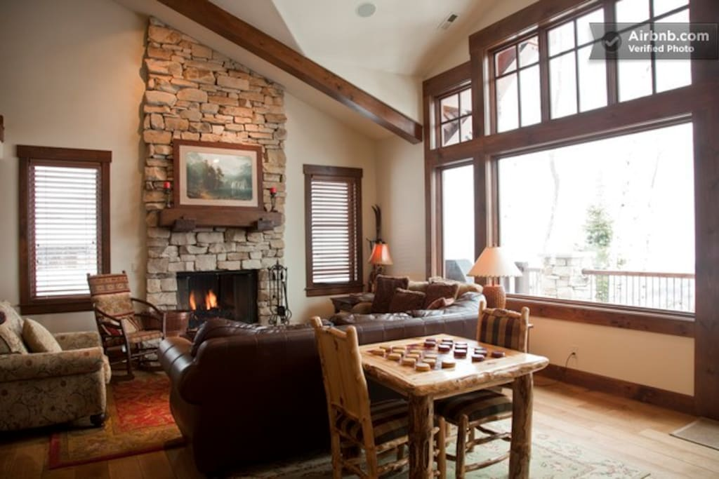 Large great room with fireplace and vaulted ceiling