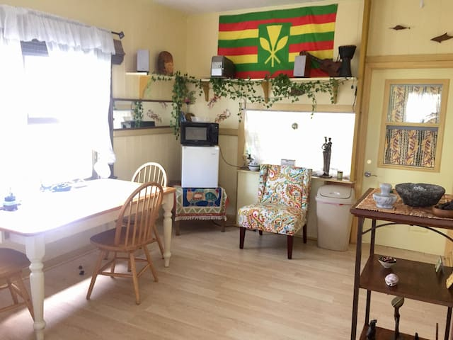 Living room with small refrigerator and microwave oven.