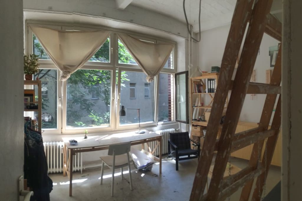 20m2 room with a desk and huge windows