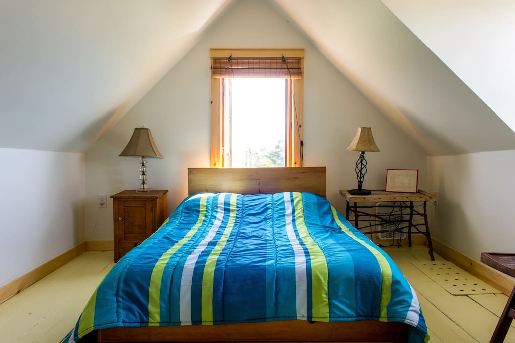 The main bedroom has a double bed. Wake up to the sounds of birds in this peaceful room.