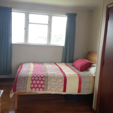 Master bedroom. Queen-size bed. Wardrobe.