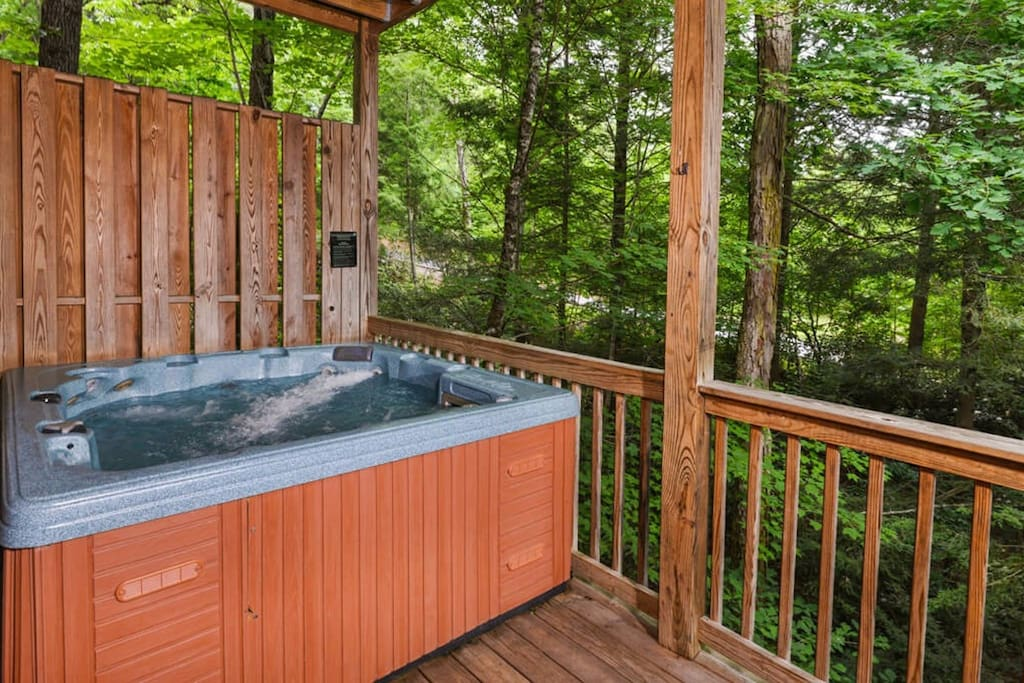 Enjoy the hot tub surrounded by the forest. This hot tub has room for 6 and has a spot with shoulder jets!