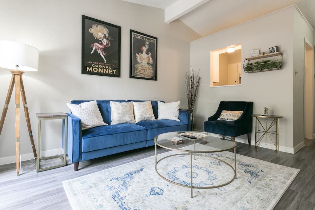 Relax on the soft blue velvet couch while you enjoy a glass of wine.