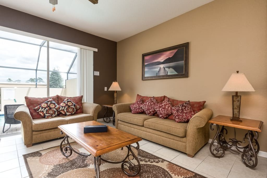 Spacious family room to relax in anytime of the day, complete with contemporary-styled decor