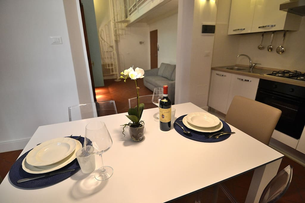 Kitchen with Oven, Fridge, Freezer, Stove and all you need to prepare your meals and so on.. The spiral staircase just bring you to a mezzanine floor which is just a relaxing area.