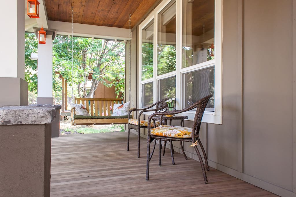Generous covered porch complete with porch swing and seating...be a part of the neighborhood.