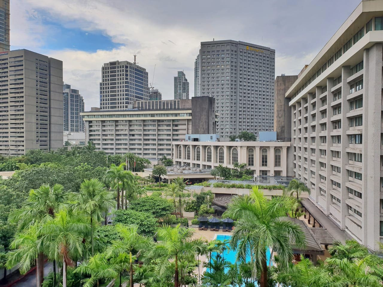 This is YOUR VIEW from the Condominium Unit overlooking the buildings in Makati (not the condo pool)