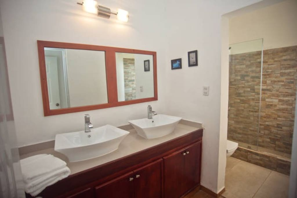 Double sinks in the master bedroom & walk-in shower (not shared)