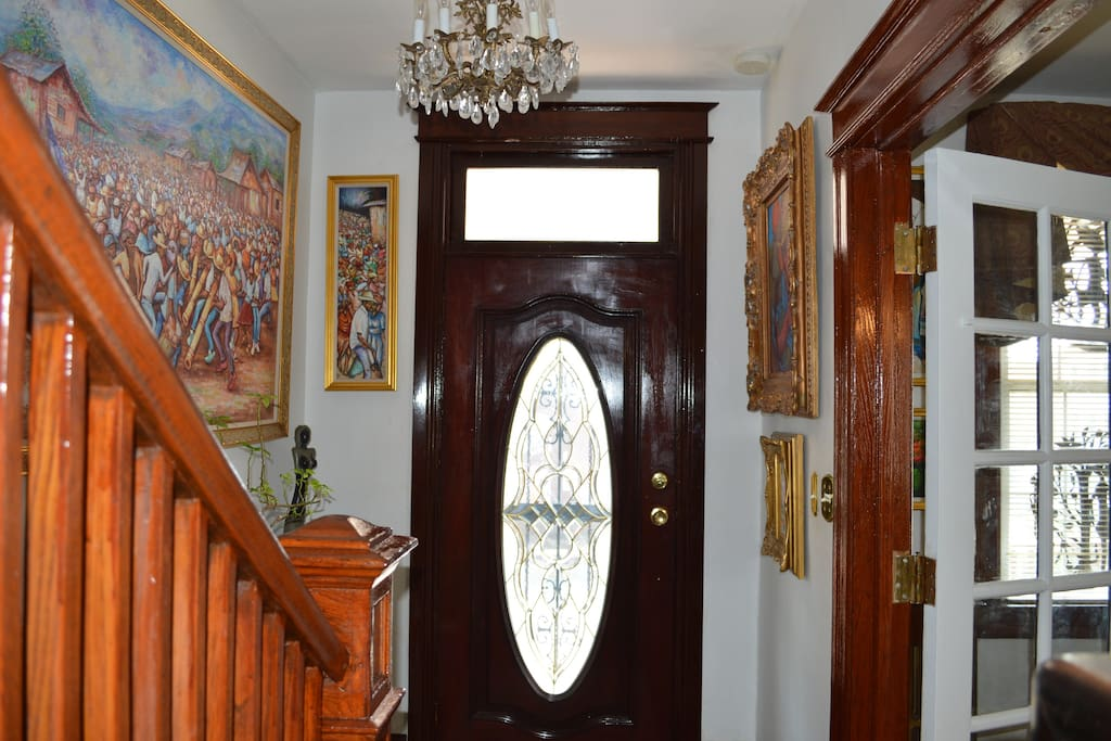 Upon entering the house, your breath will be taken away by the sight of original hardwood floors, beautiful Haitian artwork, and a homey atmosphere.