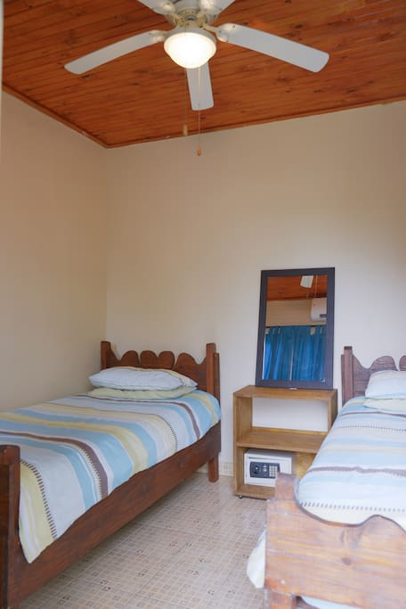 Bedroom furnished with 2 Single Bed. Air Conditioned.