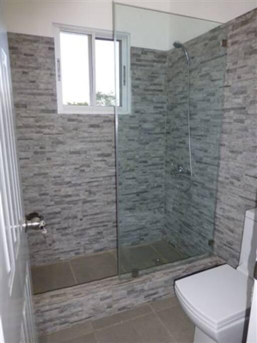 Walk-in stone shower (not shared)