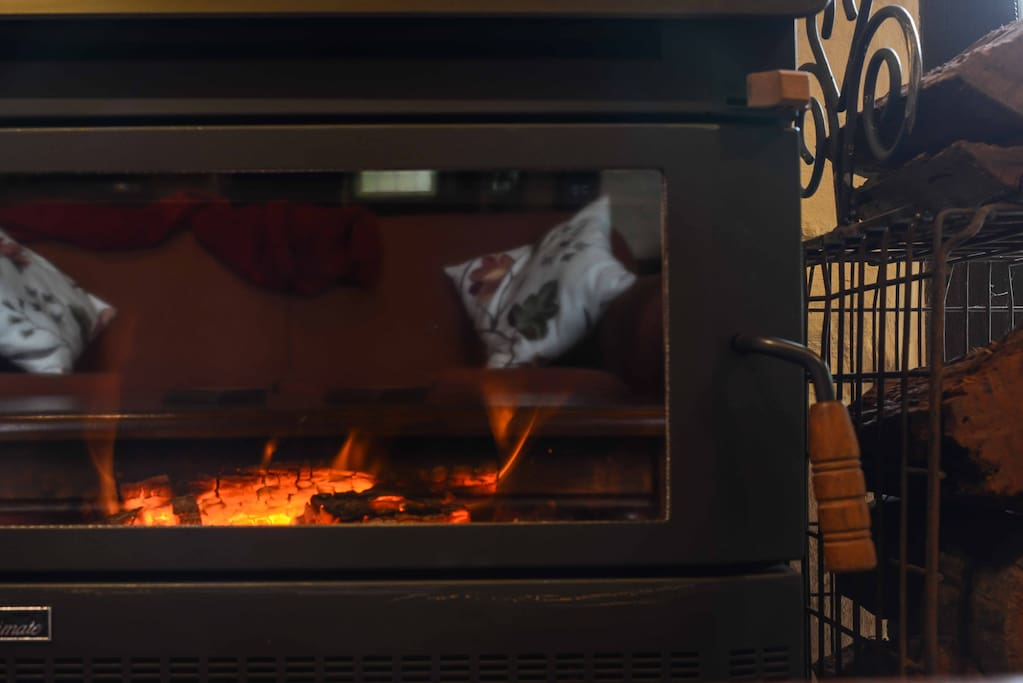 Cosy Coonara wood heater in living room - reverse-cycle air conditioner as well
