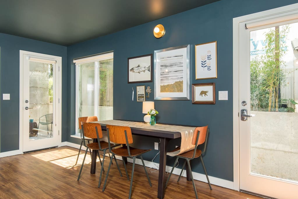 Ample lighting flows through the floor to ceiling windows and doors. The rear door leads to your private patio.