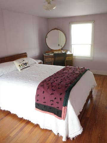 Large upstairs bedroom with both east and west facing windows