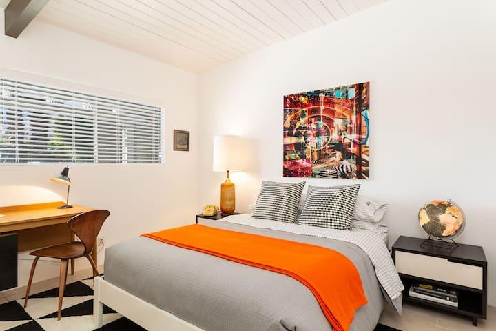 pool side guest bedroom with queen bed