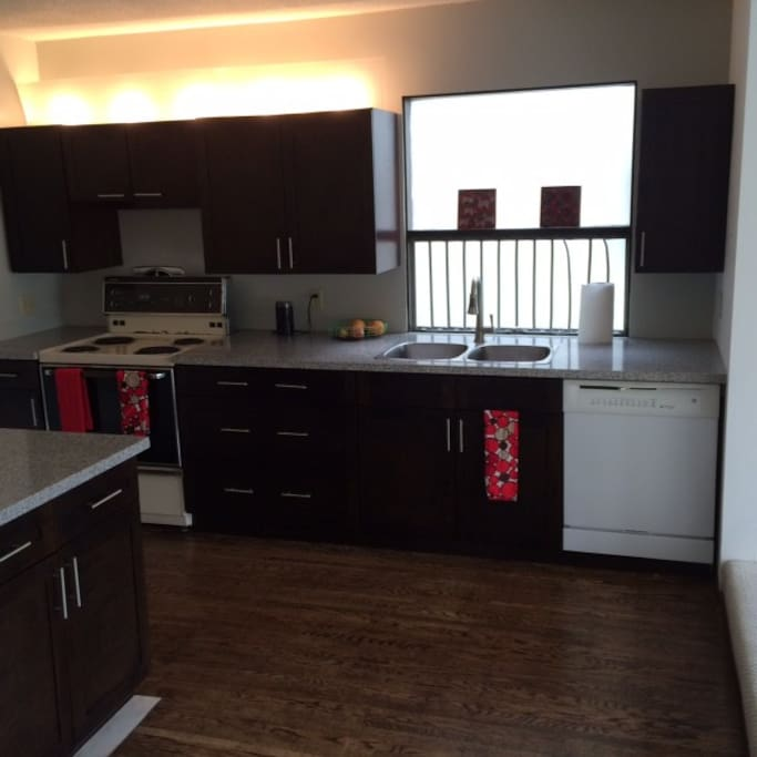 spacious, newly renovated kitchen with dishwasher