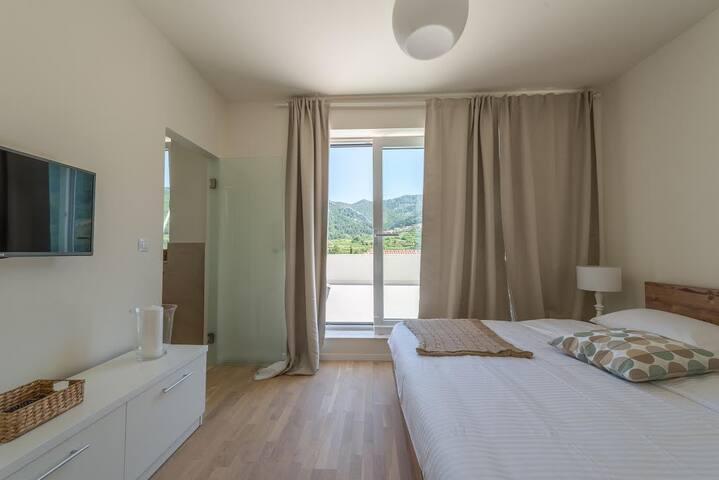 Villa Belpur | First bedroom with ensuite bathroom