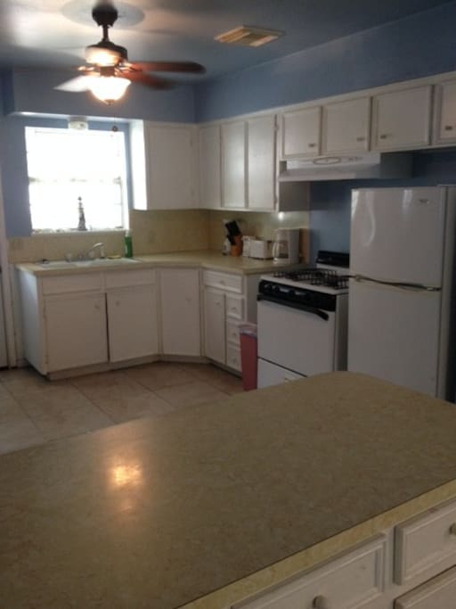 Full kitchen, stainless steel pots/pans, knife set, coffee maker, toaster and  microwave.