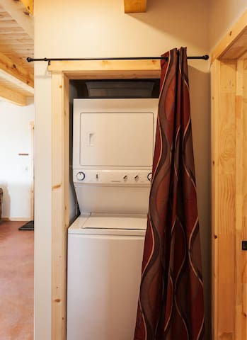 Full size washer and dryer- laundry pods provided.