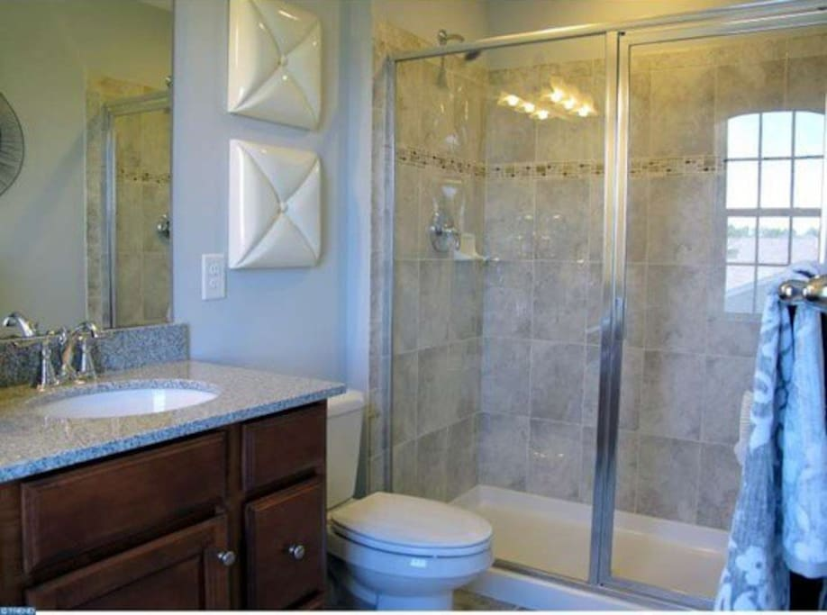 Master bath with two shower heads & granite.