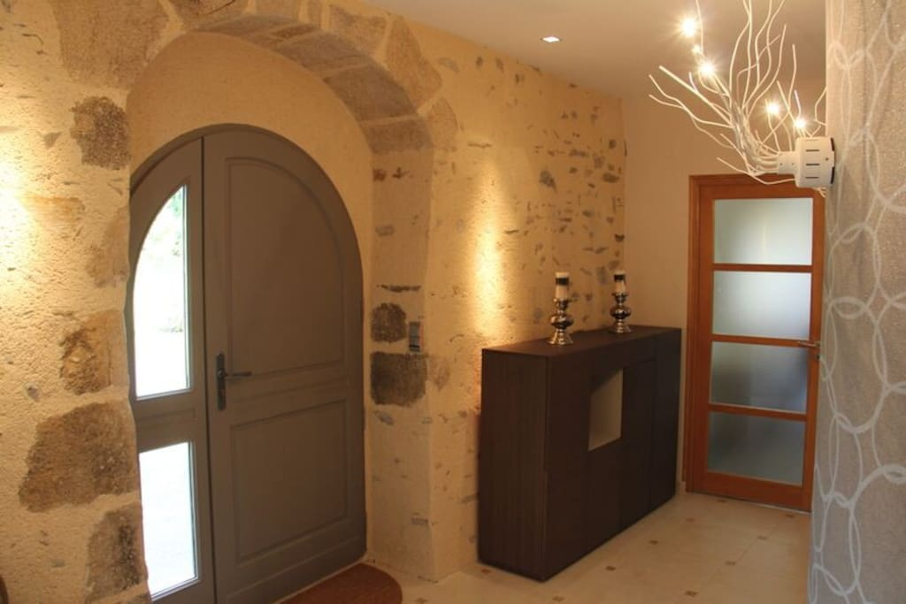 Entrance with feature stone wall & arched door