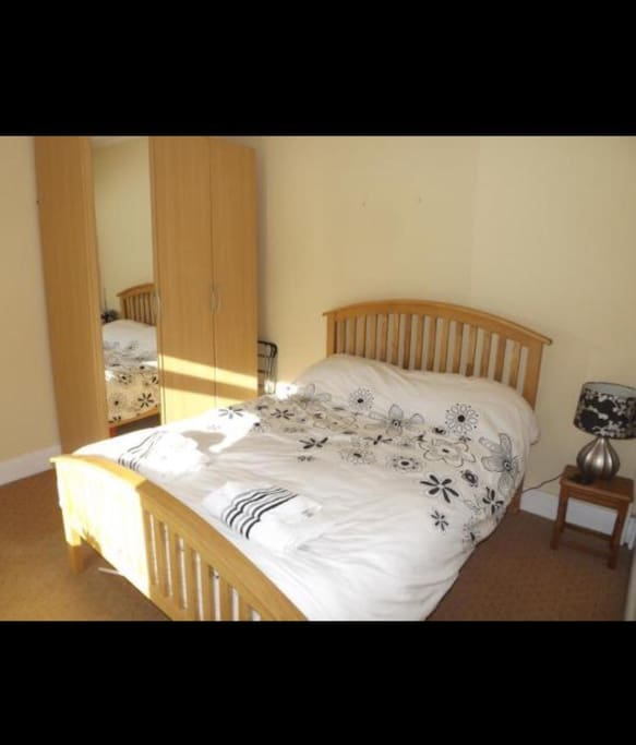 Double room with wardrobe and wifi. Locked and has use of the main bathroom across the landing
