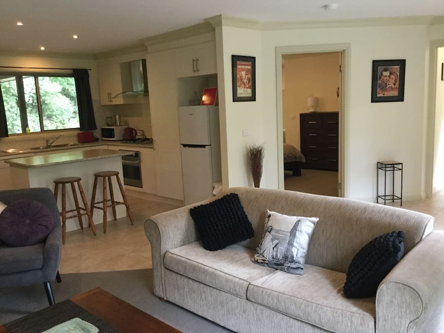 Spacious interior with kitchen, lounge and dining areas