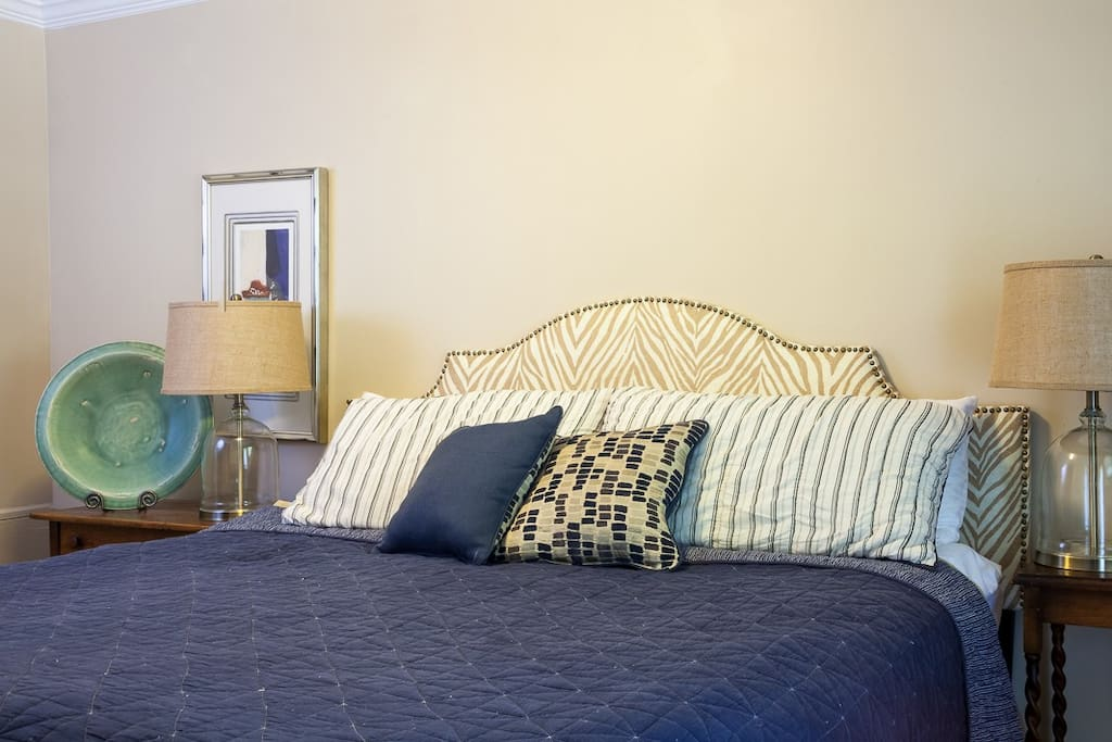Peaceful & beautifully decorated bedroom with beadboard ceilings and very comfy king