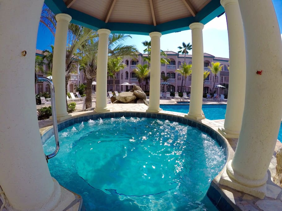 Eight person Jacuzzi overlooking the back pool..